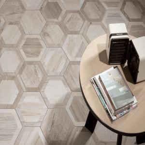 Wood look hexagon floor tile beneath coffee table