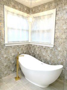 Classy elegant master bath with gold floral tile