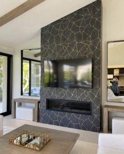 black porcelain tile fireplace in living room