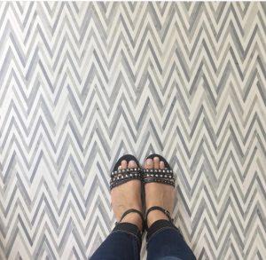 Gorgeous chevron kitchen floor tiles with ladies feet