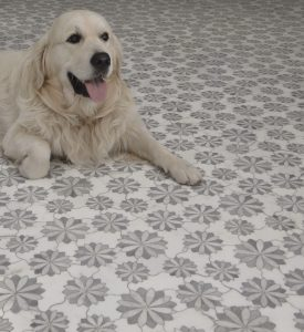 Floral kitchen floor tiles with smiling white dog