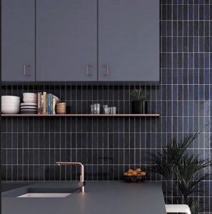 backsplash with black subway tiles vertically stacked