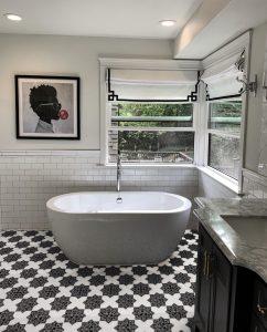 Artistic pattern floor tile in black and white bathroom