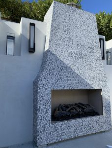 mosaic tiles outdoor on fireplace patio
