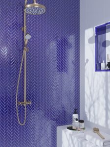 Dark blue herringbone glass tile shower