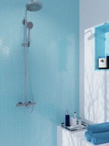 light blue herringbone glass shower tiles