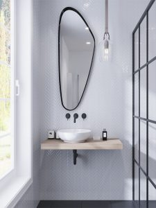 white herringbone glass tiles wall in bathroom