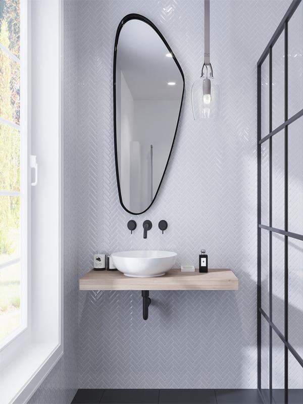white herringbone glass tiles wall in bathroom
