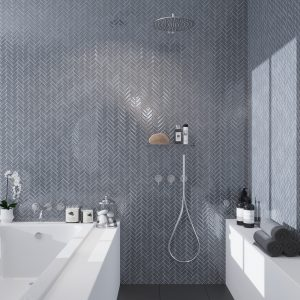 Gray glass tiles on shower wall