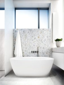 Breathtaking floral pattern tile on bathroom accent wall