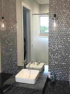 metal penny round tiles in bathroom