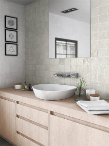 Square ceramic tile shimmering in bathroom backsplash